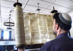 Rabbi David Ross Senter of the Temple Israel in Portsmouth, shows a Holocaust Torah on permanent loan from the Memorial Scrolls Trust in London, England. It is one of 1,564 Czech Memorial Scrolls that survived World War II.