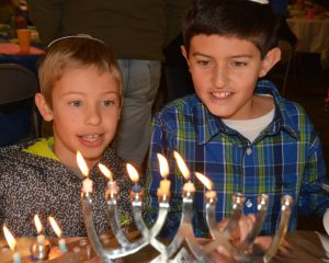 boys with Chanukah menorahs