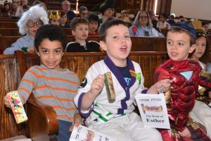 kids singing at a purim party