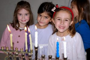 lighting chanukah menorahs