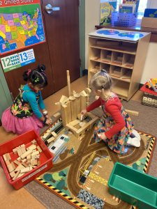 girls playing with blocks preschool