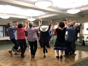 Adults Dancing in Temple Israel's Social Hall