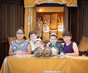 Family on the Bimah with Torah Scrolls
